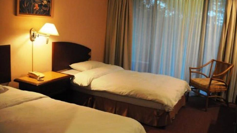 Casuarina Hotel - bedroom